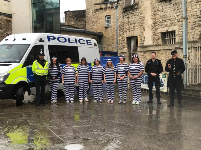 Kelly Dennychene (first left) was one of the'imprisoned' businesswomen during the Jail & Bail fundraiser for Helen & Douglas House at Oxford Castle & Prison