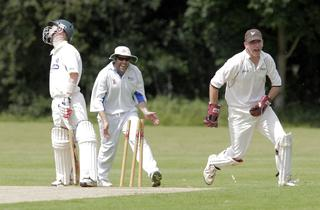 Nondies keeper Jon Guthrie (right) leads the celebration after Hanborough batsman Aston Leach is bowled out in their Division 2 clash