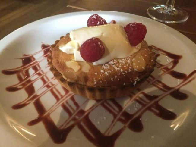 Bakewell tart and clotted cream at The Flowing Well