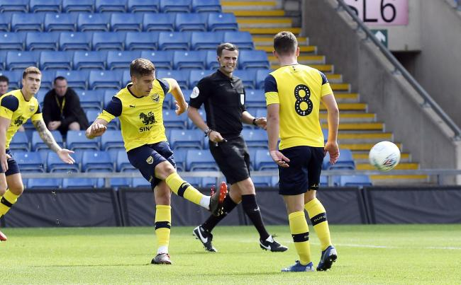 Alex Gorrin curls home superbly during Oxford United's 2-1 defeat at home to Queens Park Rangers on SaturdayPicture: David Fleming