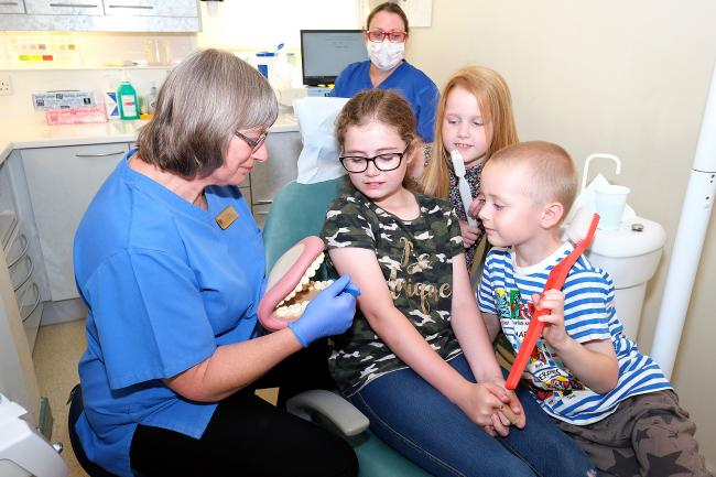 Fiona Stovold a dental hygienist at Portway Dental Care, Wantage, with Keira Ludlam, Rocco Ludlam and Cerys Ludlam. Picture: Ric Mellis
