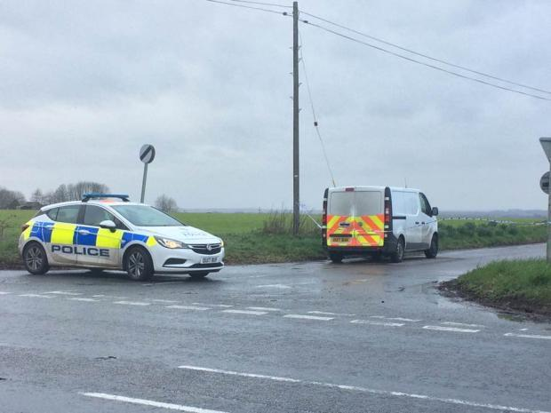 Police at the scene of the car fire near Ardington Wick Farm, Oxfordshire