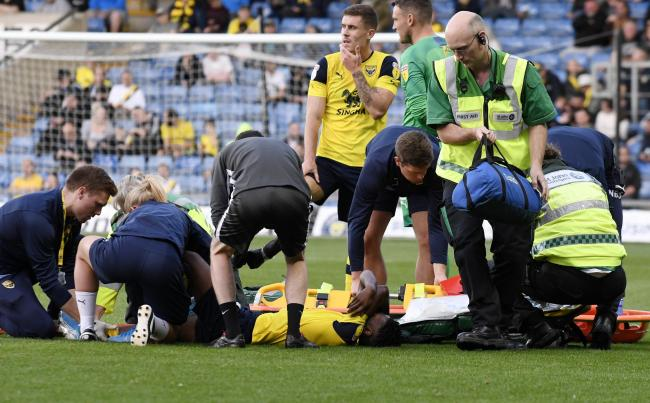 Oxford United's Malachi Napa receives treatment on the pitch last night  Picture: David Fleming