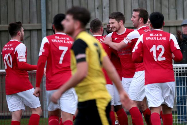 Adam Learoyd (centre) is congratulated after scoring for Didcot Town against North Leigh. Last season's skipper has now joined the Millers from the RailwaymenPicture: Ric Mellis