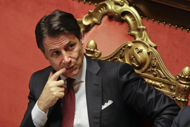 Italian PM asked to stay as caretaker leader after