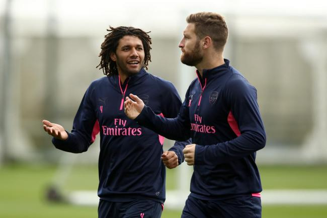 Arsenal's Mohamed Elneny (left) and Shkodran Mustafi have been told they can leave