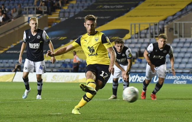 James Henry scores Oxford United's equaliser against Millwall on Tuesday   Picture: David Fleming