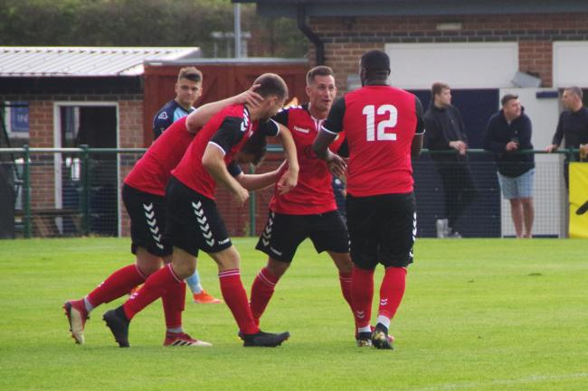 North Leigh captain Ben Brown is swamped after making it 2-0 in his side's impressive win on SaturdayPicture: Edward Martin