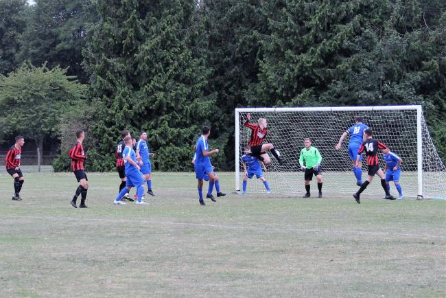 George Kay scores Dorchester's second goal against Kingston Colts