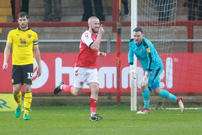 Paddy Madden wheels away after scoring Fleetwood Town's second goal against Oxford United in January Picture: Richard Parkes