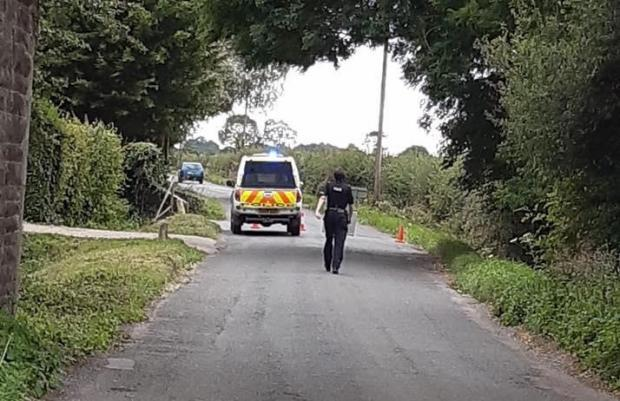 Police cordoned off the road. Pic: Emma Lovell