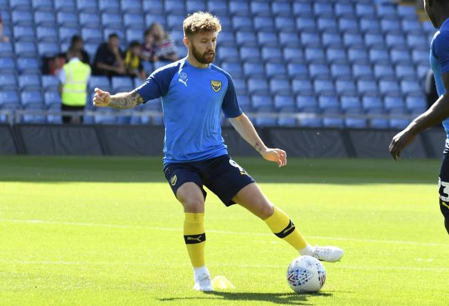 Matty Taylor takes part in Oxford United's warm-up on his return to the side on Saturday   Picture: David Fleming
