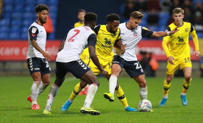 Tariqe Fosu is outnumbered as he gets forward for Oxford United at Bolton Wanderers  Picture: Richard Parkes