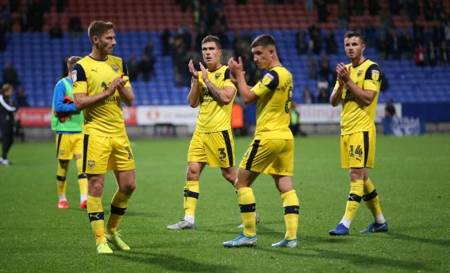 Oxford United's players applaud the travelling support after the final whistle at Bolton Wanderers, before heading to their hotel   Picture: Richard Parkes