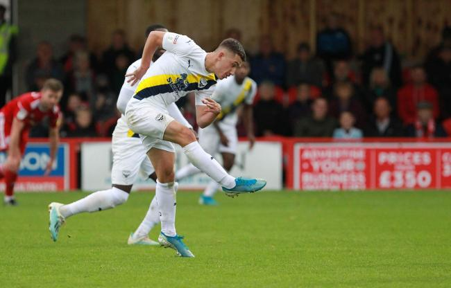 Cameron Brannagan lashes in a long-range shot for Oxford United Picture: Richard Parkes
