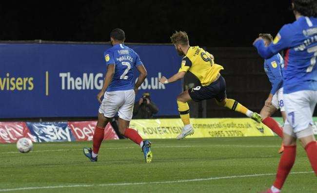 Matty Taylor fires Oxford United ahead against Portsmouth   Picture: David Fleming