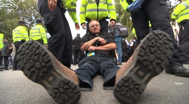 Screen grab from Channel 4 News. Vicar Tim Hewes after being arrested at the London protests