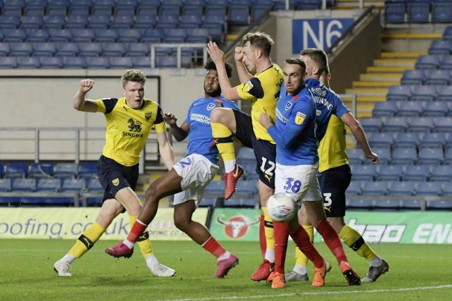 Rob Dickie scores for Oxford United in the group clash with Portsmouth last month  Picture: David Fleming