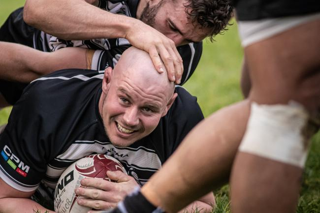 Nick Selway celebrates after scoring his second try for Chinnor against Sale, with Carl Kirwan first to congratulate him Picture: David Howlett