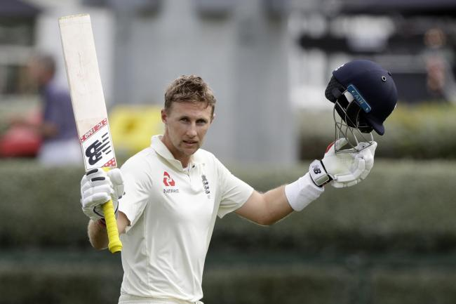 Joe Root salutes the crowd after his double-hundred in Hamilton