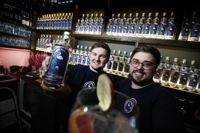 Sam Smith and Rob McGregor show off their new non-pink pink gin Albino Flamingo. Picture: Ed Nix