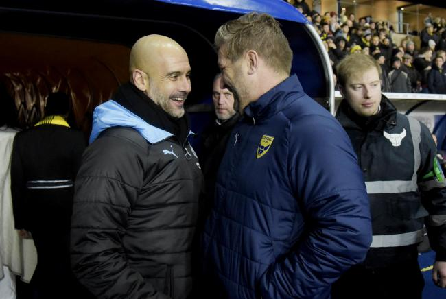 Manchester City boss Pep Guardiola has a chat with Oxford United head coach Karl Robinson before December's Carabao Cup quarter-final  Pictures: David Fleming