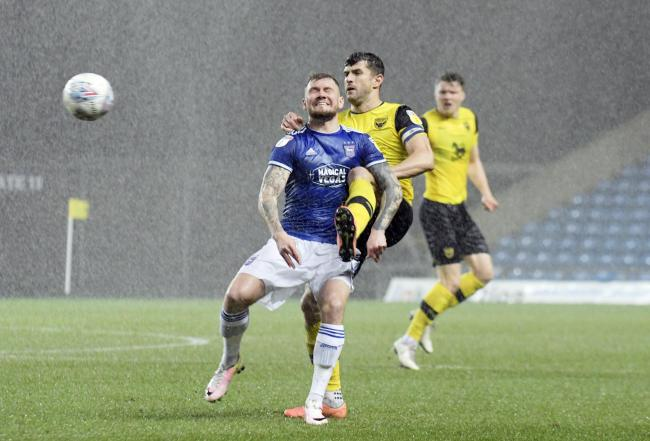 John Mousinho puts in a challenge during Oxford United's weather-affected draw with Ipswich Town. Storm Dennis is forecast to bring similar conditions to the Kassam tomorrow      Picture: David Fleming