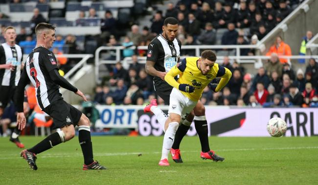 Marcus Browne stumbles as he fires a big chance to put Oxford United in front straight at Newcastle United goalkeeper Karl Darlow Picture: Richard Parkes
