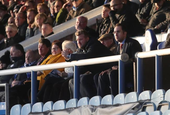 Oxford United boss Karl Robinson watches on from the directors' box at Peterborough United due to a touchline ban  Picture: Richard Parkes