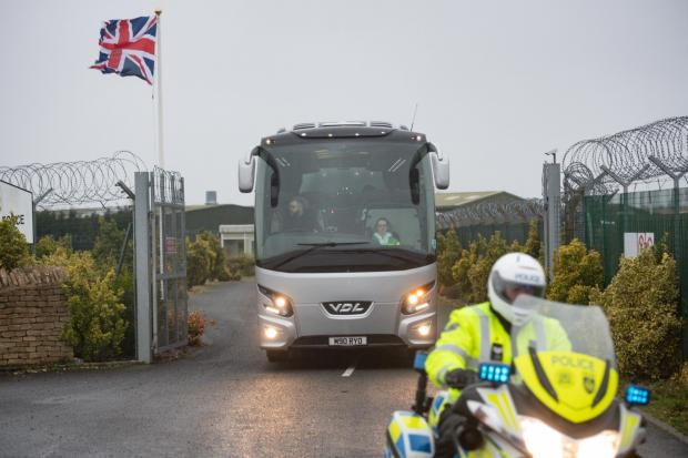 Herald Series: A coach leaves RAF Brize Norton with passengers from Wuhan. Picture: Jacob King/PA