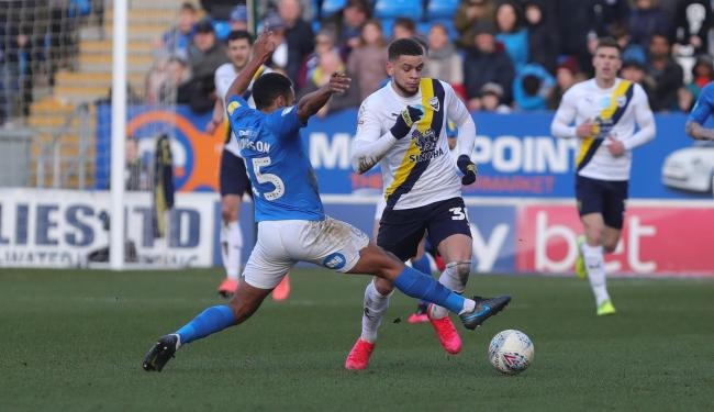 Marcus Browne (right) in action for Oxford United at Peterborough United last season. The forward will not be with the squad on their return tomorrow after Middlesbrough decided against a loan move   Picture: Richard Parkes
