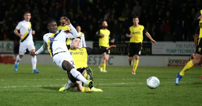 Dan Agyei scores Oxford United's first goal of the night at Burton Albion  Picture: Richard Parkes