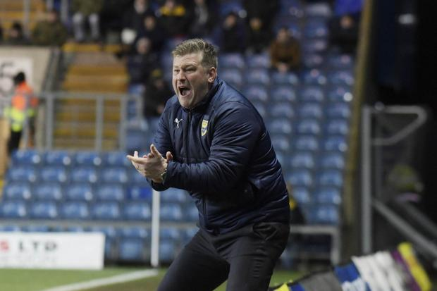 Karl Robinson urges Oxford United on from the touchline against AFC Wimbledon   Picture: David Fleming