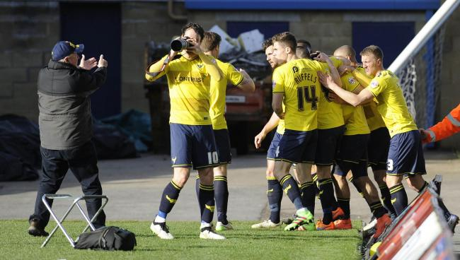 Danny Hylton borrows Steve Daniels's camera after Liam Sercombe puts ten-man  Oxford United ahead against Stevenage   Picture: David Fleming