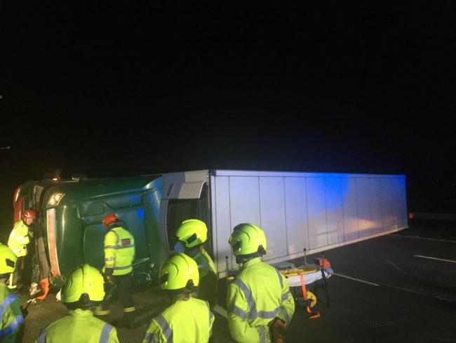 Firefighters rush to an overturned lorry in an early morning drama