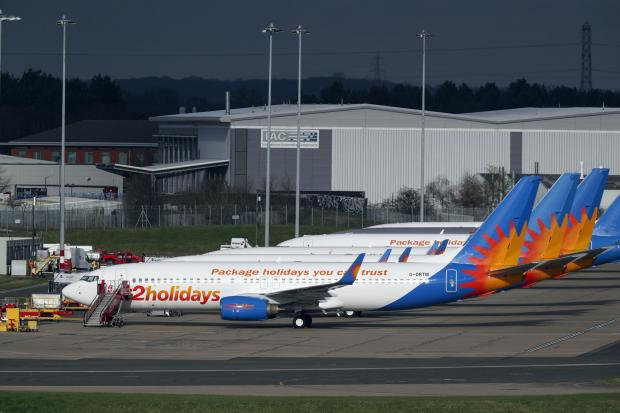 Herald Series: AIRLINE: Several Jet2 planes have been parked up at Birmingham Airport during the pandemic. Picture: Steve Parsons/PA
