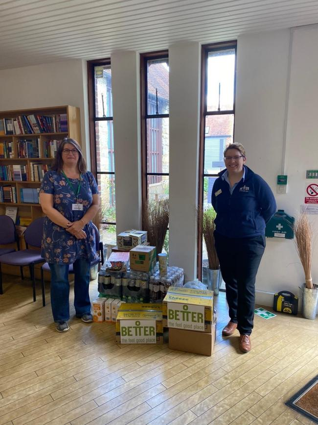 Pam Radley, operations manager at the leisure centre, hands over donations to Abingdon Food Bank volunteer Liz Moore.