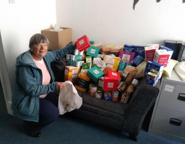 OXM_28/05/2020_8_Dpg Hilary Beale (Volunteer) with the food items donated by David Wilson Homes - Image received from Abingdon Foodbank