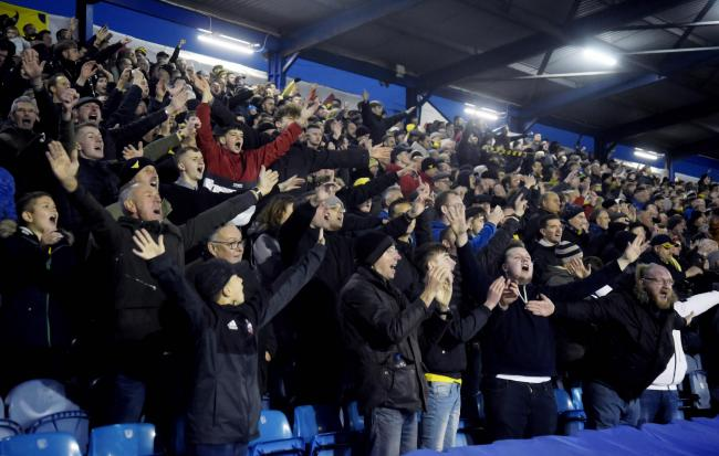 Oxford United fans celebrate their late equaliser at Fratton Park in November. Tonight the stands at Portsmouth will be empty, a scenario which will be unfamiliar to the players   Picture: David Fleming