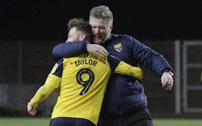 Oxford United boss Karl Robinson with Matty Taylor   Picture: David Fleming