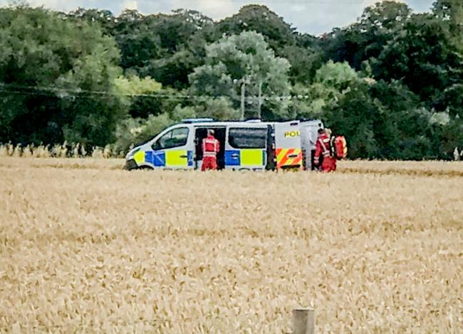 Air ambulance and large police presence in field because of 'serious emergency'