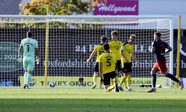 Oxford United goalkeeper Simon Eastwood retrieves the ball from his net after Sunderland go 2-0 up Pictures: David Fleming