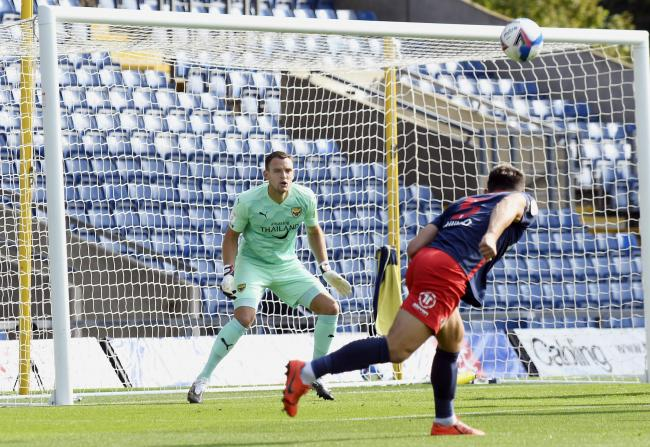 Simon Eastwood can only watch as Bailey Wright heads on to the crossbar Picture: David Fleming