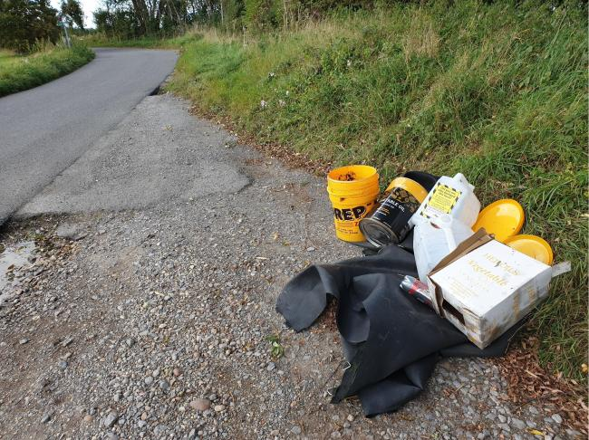 Restaurant fly-tips countryside with old oil containers