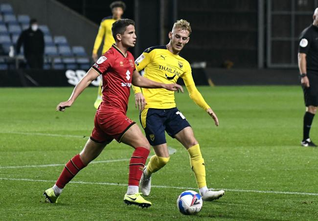 Mark Sykes (right) in action against MK Dons last week           Picture: David Fleming