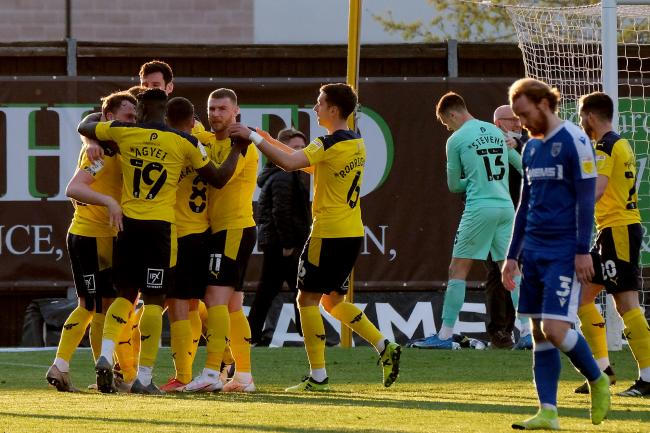 Delighted Oxford United players celebrate their dramatic comeback win against Gillingham Picture: Ric Mellis