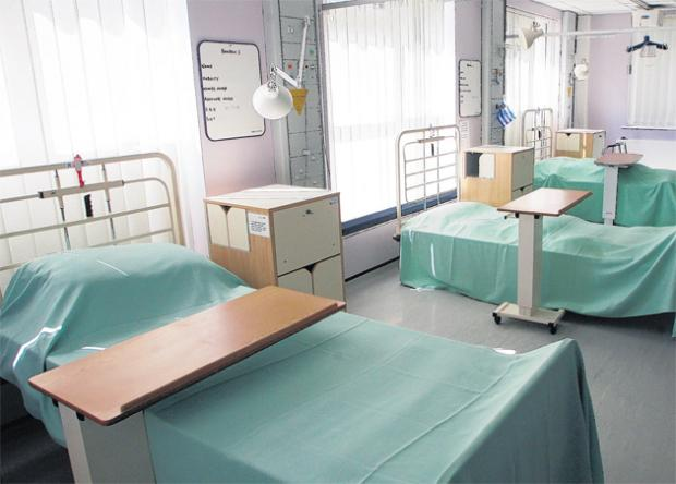 Community hospital bed numbers halved