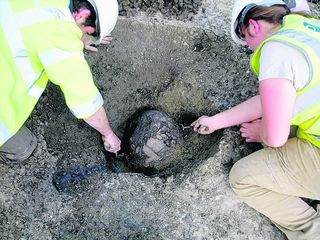 A neolithic pot under excavation at the housing site
