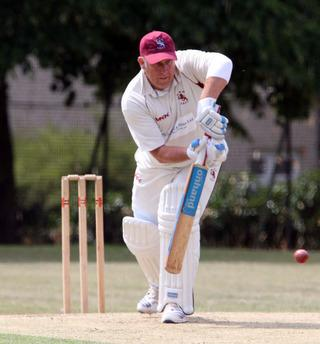 Kingston Bagpuize's Dave Ward defends against Witney Mills during their Division 3 match on Saturday