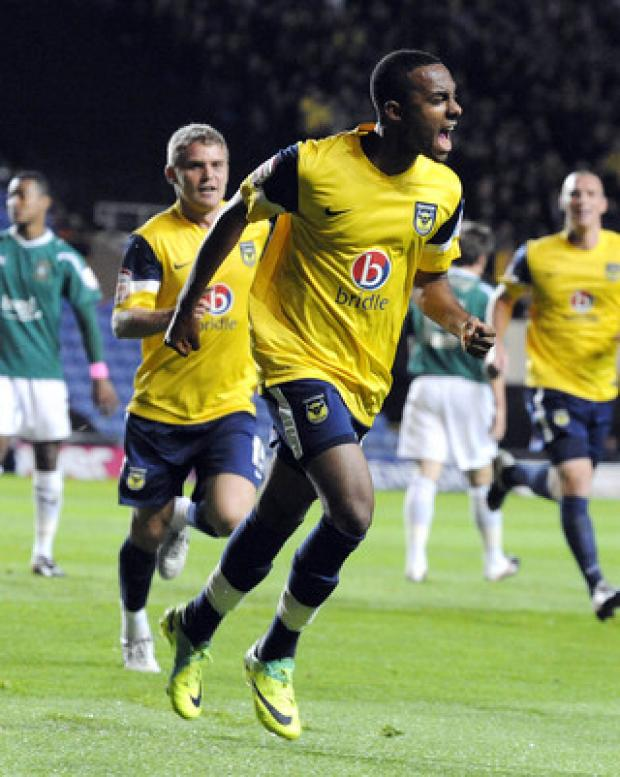 Herald Series: Oxford United teenager Rob Hall celebrates the first of his double against Plymouth on Tuesday night